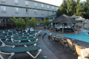 A shot of the Commodore Resort and MIST Pool Bar, during calm hours.